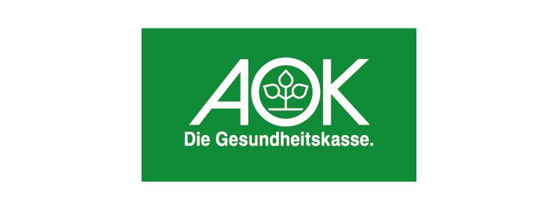 Loko der Gesundheitskasse AOK auf grünem Hintergrund